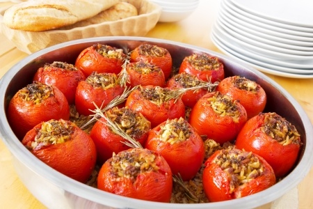 15506514 - stuffed tomatoes in a round casserole fresh out of the oven